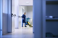 Women at workplace, female cleaner washing floor Stock Images