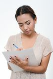 Women write in a paper Stock Photos