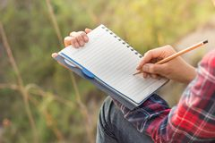 Women writers take note of nature studies. Travel ideas royalty free stock photography