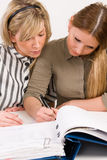Women writing Stock Images