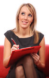 Women writing in red folder Stock Photos