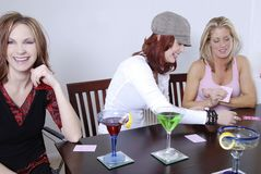 Women wth cocktails playing po Royalty Free Stock Photo