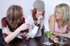 Women wth cocktails playing po Royalty Free Stock Image