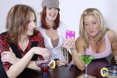 Women wth cocktails playing po Stock Image