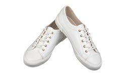 Women& x27 ; chaussures blanches de sport de s d'isolement sur le fond blanc Photos stock