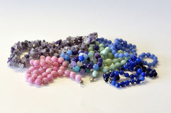 Women& x27;s beads from natural semiprecious stones on a white backgr Royalty Free Stock Photos