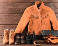 Women's clothing and accessories. Brown suede jacket, three diff Royalty Free Stock Image