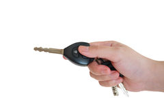 Women's hand presses on the remote control car alarm systems Royalty Free Stock Photos