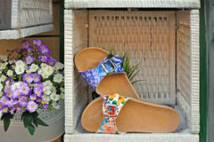 Women's sandals with floral print in woven box Royalty Free Stock Photography