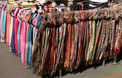 Women's summer hats and scarves at the street market Stock Photos
