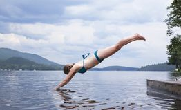 Women's Diving on Lake in Green Bikini Royalty Free Stock Images