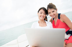 Women in a yacht with a laptop Royalty Free Stock Image