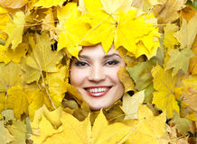 Women in the yellow autumn leaves. Stock Photos