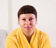 Women in yellow bathrobe. At home royalty free stock photo