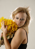 Women with yellow flowers Royalty Free Stock Image