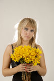 Women with yellow flowers. There is women with yellow flowers looks at you stock image