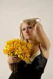 Women with yellow flowers. There is women with yellow flowers looks at you royalty free stock photo