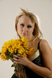 Women with yellow flowers. There is women with yellow flowers looks at you stock photography