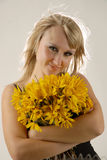 Women with yellow flowers. There is women with yellow flowers looks at you royalty free stock images