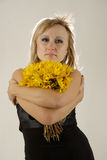 Women with yellow flowers. There is women with yellow flowers looks at you stock photo