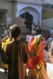 Women in yellow saris Royalty Free Stock Images