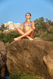 Women in Yoga meditation pose. At amazing sunset royalty free stock photos