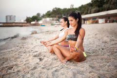 Women in Yoga meditation pose. At amazing sunset royalty free stock photo