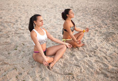 Women in Yoga meditation pose. At amazing sunset royalty free stock image