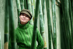 Women in zhe bamboo forests royalty free stock image
