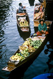 Womenn on fruit boat Royalty Free Stock Images