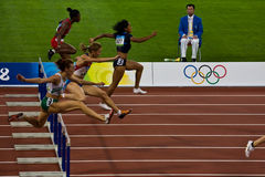 Womens 100M Olympic hurdle race. Womens 100 meter hurdles race in Beijing China Royalty Free Stock Images