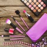 Womens accessories cosmetic bag, makeup brushes, necklace, nail polish, lipstick. Royalty Free Stock Images