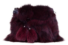Womens bag with fur on white Royalty Free Stock Photography