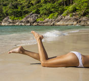 Womens beautiful legs on the beach Stock Images