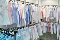 Womens blouses and shirts in store Royalty Free Stock Photography