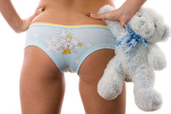 Womens buttom with soft toy. Stock Photography