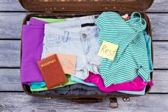 Womens clothes and accessories. Rest and vacation concept. Passport and mail, flat lay top view Royalty Free Stock Photos