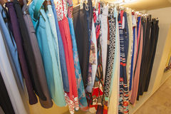 Womens clothes hanging on a rail Royalty Free Stock Image