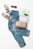 Womens clothing collection. Full  female look, sandals, jeans, handbag, shirt on white background Royalty Free Stock Photo