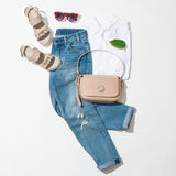 Womens clothing collection. Full  female look, sandals, jeans, handbag, shirt on white background Stock Images