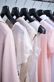 Womens clothing pastel colors hanging on the hanger vertical Royalty Free Stock Photos