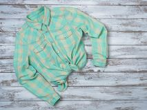 Womens clothing plaid shirt. Fashion outfit, spring summer collection. Shopping concept. Flat lay, top down view royalty free stock photography