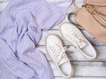 Womens clothing, shoes, accessories lavender dress, white leather sneakers, beige backpack. Fashion outfit, spring summer stock images