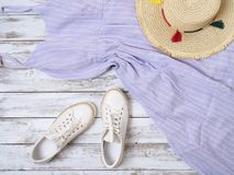Womens clothing, shoes, accessories lavender dress, white leather sneakers, straw hat. Fashion outfit, spring summer collection royalty free stock photo