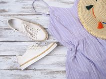 Womens clothing, shoes, accessories lavender dress, white leather sneakers, straw hat. Fashion outfit, spring summer collection royalty free stock image