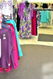Womens clothing store. Beautiful ladies clothes on display in a womens clothing store Stock Photo
