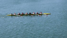 Womens Crew Team Rowing On Lake Panned Shot. Panned Shot Of Womens Crew Team Rowing On Lake