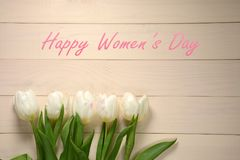 Womens Day card. White tulips on wooden background stock photography