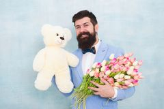 Womens day. Formal mature businessman bride groom at wedding party. love date with flowers. Happy Birthday. spring. Bouquet. 8 of march. bearded man in bow tie royalty free stock photos