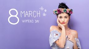 Womens Day message with beautiful woman with a garland. Womens Day message with beautiful young woman with a garland royalty free stock image